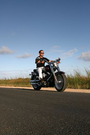A man cruises on a classic style motorbike