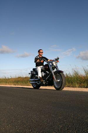 A man cruises on a classic style motorbike Stock Photo - 3758494