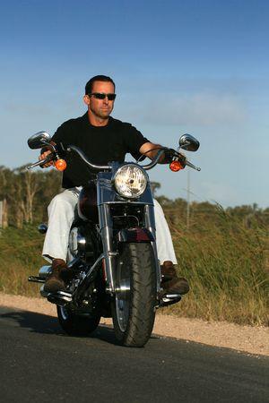 cruiser bike: A man cruises on a classic style motorbike