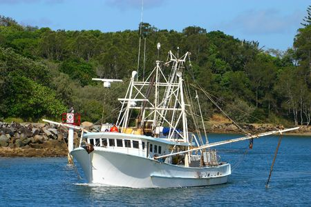 A medium sized trawler heads out to do some fishing