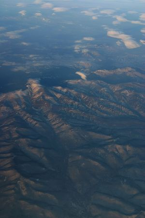 a aerial view of mountains over Siberia in winter