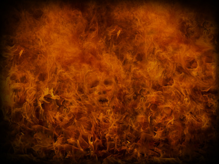 abstract fire: Fire background with small skulls hiding in the flames. Great for music and heavy metal styles.