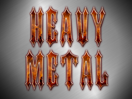 Heavy Metal wording made from flames and chromemetalsteel on a silver metallic background.