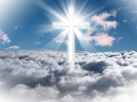 wooden cross: A cross in the sky with light rays on a bright sunny day.