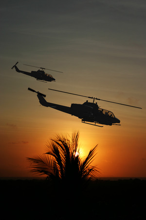 impression: Vietnam War style image circa 1970 two helicopters flying over South Vietnam looking for the North Vietnamese Army. (Artists Impression)