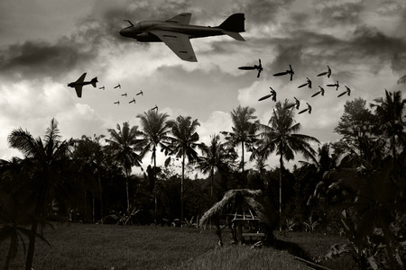intruder: Vietnam War style B&W image circa 1970 of two Intruder fighter bombers flying low over the rice paddies of South Vietnam unloading their bomb arsenal on the enemy positions. (Artists Impression)