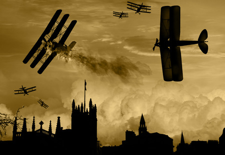Vintage world war one biplanes and triplanes engaged in a dog fight over a country town. Success in shooting down the enemy plane. Original Illustration image. Stock Photo