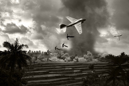 Vietnam War style B&W image circa 1970 of two Intruder fighter bombers flying low over the rice paddies of South Vietnam unloading their bomb arsenal on the enemy positions. (Artists Impression)