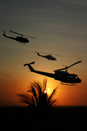 circa: Vietnam War style image circa 1970 three helicopters flying over South Vietnam looking for the North Vietnamese Army. (Artists Impression)
