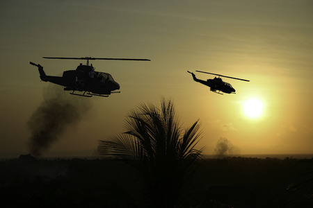 circa: Vietnam War style image circa 1970 two helicopters flying over South Vietnam looking for the North Vietnamese Army. (Artists Impression)