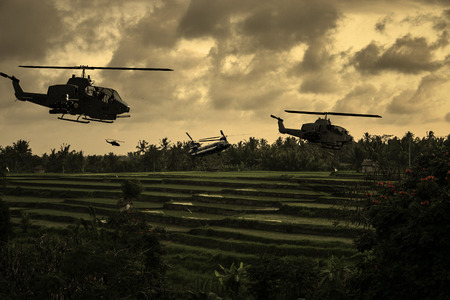 circa: Vietnam War style image circa 1970 helicopters flying over South Vietnamese rice paddies looking for the North Vietnamese Army. (Artists Impression) Stock Photo