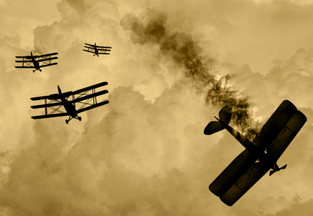 Vintage world war one biplanes and triplanes engaged in a dog fight  in a cloudy sky. One had success in shooting down the enemy plane. Original Illustration image. Stock Photo