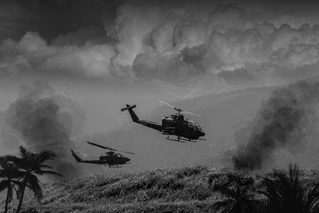 vietnam war: Vietnam War style B&W image circa 1968 of two helicopter gunships flying low over the jungle of South Vietnam looking for Viet Cong and the North Vietnamese Army. (Artists Impression)