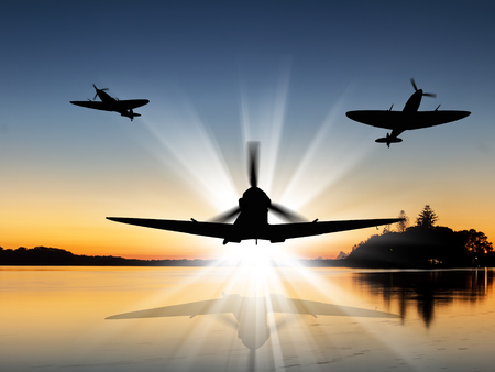 Silhouette of Vintage British World War 2 fighters flying low over a river at sunrise - Artists Impression.