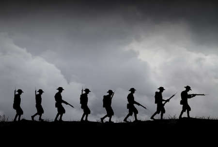 Silhouette of Australian ANZAC soldiers against the sky.(Artist drawn silhouette on photo background)