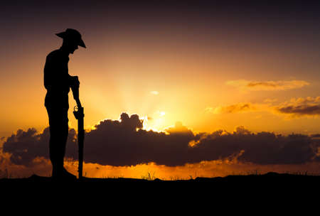 Silhouette of Australian ANZAC soldiers against the sky.(Artist drawn silhouette on photo background) 版權商用圖片