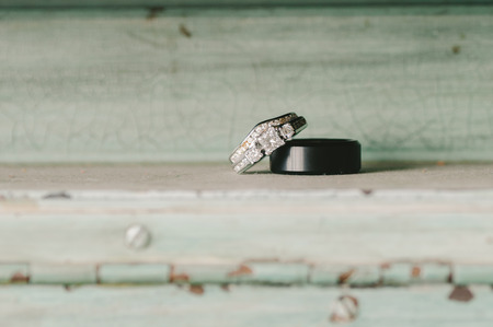 wedding bands: Wedding Bands on Mint Green Vintage Wooden Shelf Stock Photo