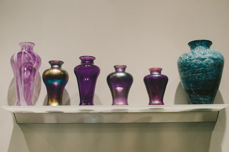 Purple  Blue Vases on Shelf Stock Photo
