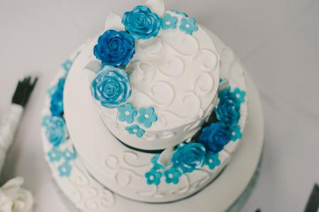 tiered: Blue  White Floral Round Tiered Wedding Cake