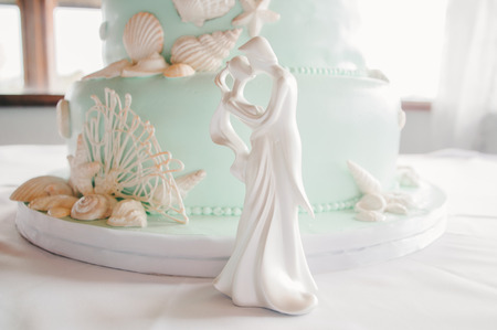 topper: Bride  Groom Cake Topper with Beachy Cake Stock Photo