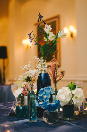 decor: Blue  White Indoor Wedding Reception Table Centerpieces