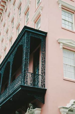 Pink Charleston Building with Black Iron Balcony