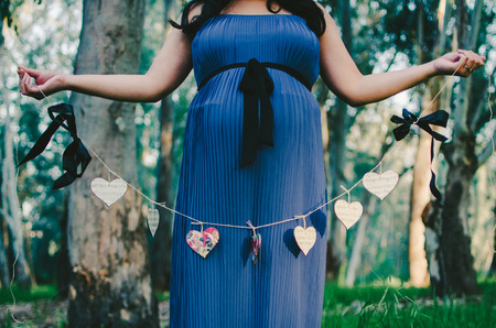 Pregnant Woman Holding Heart Banner Stock Photo