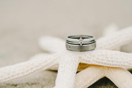 destination wedding: Wedding Rings on Starfish Stock Photo