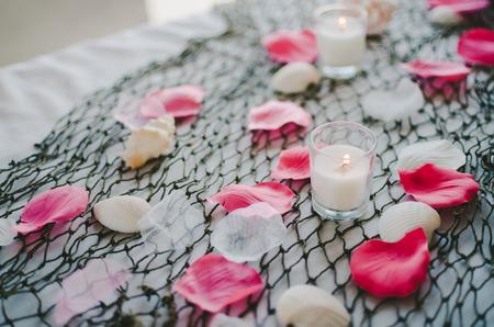 boda en la playa: Candle  Petal Table Display at Beach Wedding