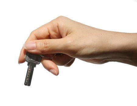 key with fingers isolated on white background Stock Photo