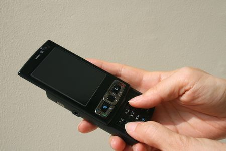 Black mobile phone in hand prepare to make a call