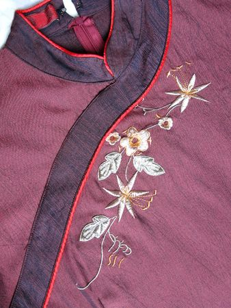Chinese style dressing close up view with flower and collar, usually wears during new year day or wedding Stock Photo