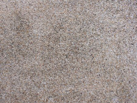 small rock pebble flooring's texture in brown color photo