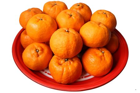 Oranges on a plate isolated on white Stock Photo