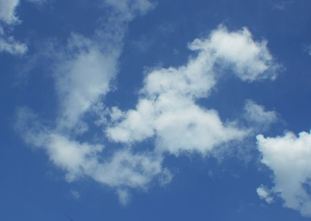 blue sky with a lots of white puffy clouds