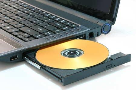 Gold color DVD on laptop for burning and backup