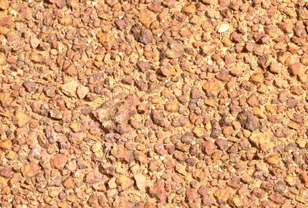 Closeup of scattered brown pebbles as background Stock Photo