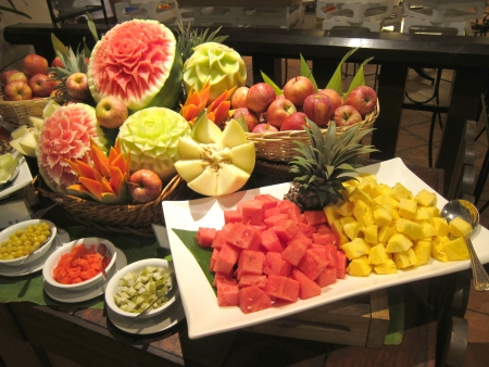 Variety of different tropical fruits in a restaurant