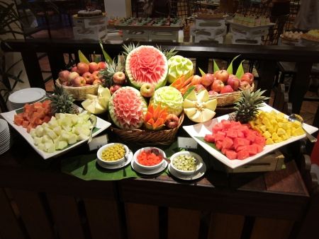 Variety of different tropical fruits in a restaurant, front view
