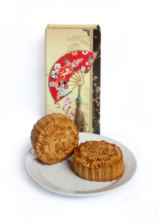 Moon cakes with gift box and plate isolated on white background