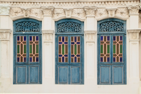Blue clolour wooden windows with decoration from Singapore china town. Stock Photo
