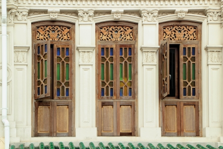 Brown clolour wooden windows with decoration from Singapore china town.