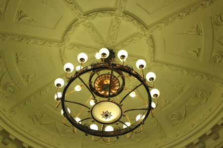 Antique lighting in old Hotel ceiling Stock Photo
