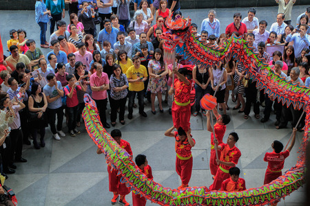 Singapore, Change Alley at Raffles Place - February 7th, Chinese New Year dragon dance performance, to celebrate the Lunar New Year on 7 Feb 2014    Editorial