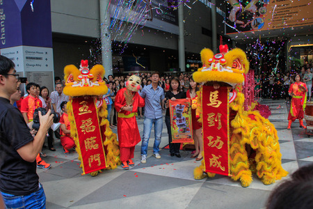 Singapore, Change Alley at Raffles Place – February 7 ; Chinese New Year lion dance, to celebrate the Lunar New Year on 7 Feb 2014 Editorial