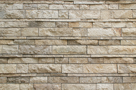 paysagiste: Pierre mur texturisée arrière-plan de couleur brun clair