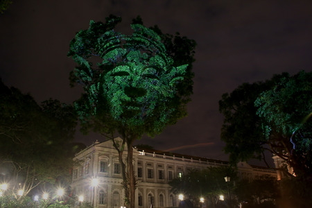 Night surreal lighting on big trees, projections of divine figures at the Singapore  National Museum Editorial