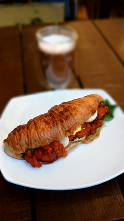 Masala Chicken, Croissant bread, egg and vegetable with tea Stock Photo
