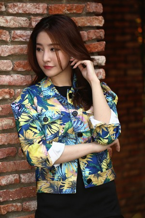 Young and beautiful asian woman model doing a fashion shoot outdoor