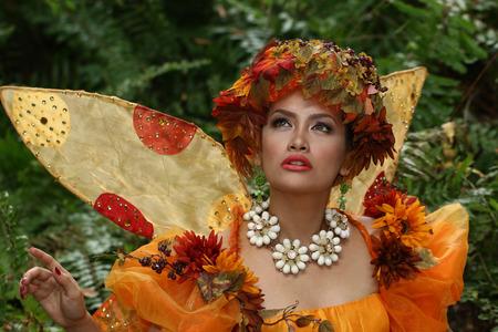 Asian model wearing fairy-tale costume having a fashion shoot